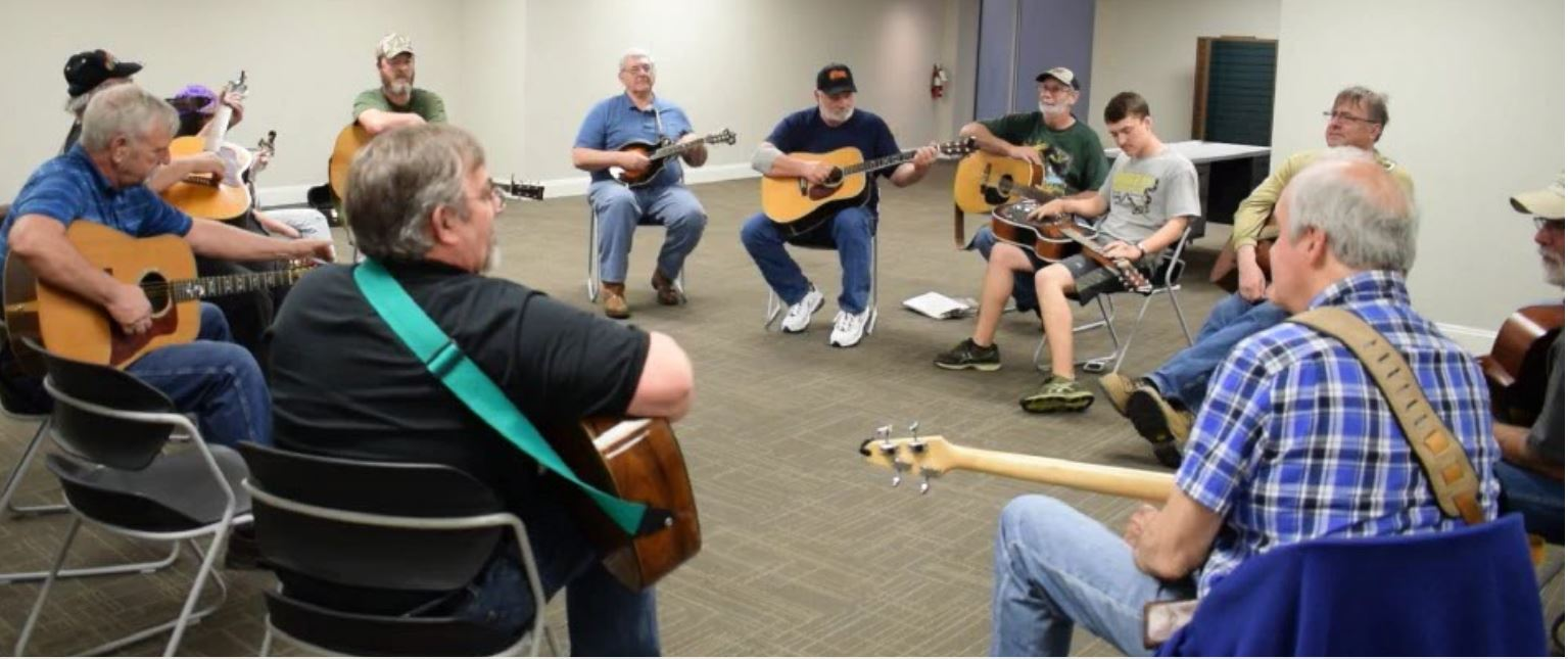 photo of participants at acoustic night with guitars